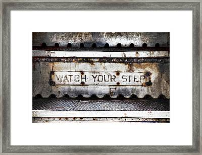 Watch Your Step Sign Framed Print by Carol Leigh