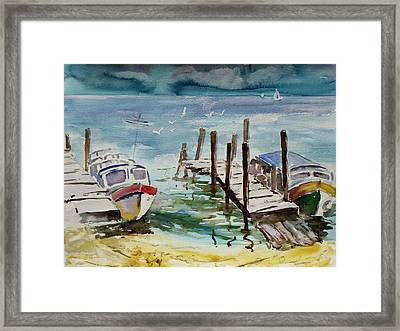 Water Taxis Framed Print by Xueling Zou