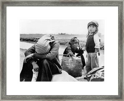 Weary Vietnamese Refugees Framed Print by Underwood Archives