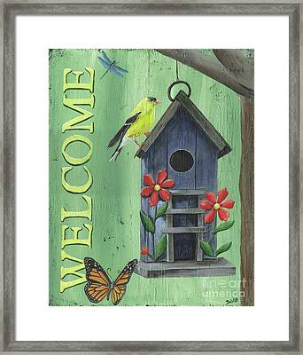 Welcome Goldfinch Framed Print by Debbie DeWitt