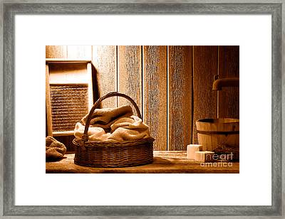 Western Laundromat - Sepia Framed Print by Olivier Le Queinec