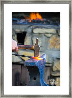 While The Iron Is Hot Framed Print by Inge Johnsson