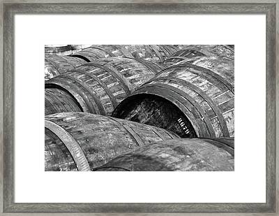 Whisky Barrels Framed Print by (C)Andrew Hounslea