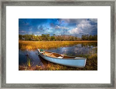White Canoe Framed Print by Debra and Dave Vanderlaan