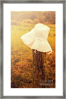 White Knitted Hat On Farm Fence Framed Print by Jorgo Photography - Wall Art Gallery