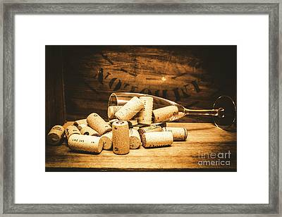 Wine Glass With An Assortment Of Bottle Corks Framed Print by Jorgo Photography - Wall Art Gallery