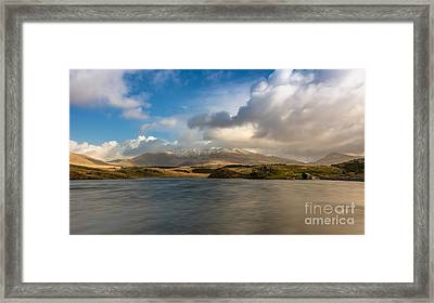 Winter Mountains Framed Print by Adrian Evans