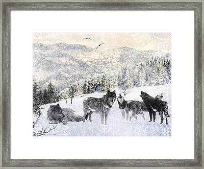 Winter Wolves Framed Print by Lourry Legarde