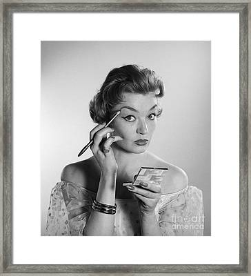 Woman Applying Makeup, C.1950-60s Framed Print by Corry/ClassicStock