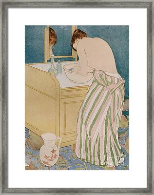 Woman Bathing Framed Print by Mary Stevenson Cassatt