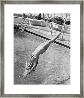 Woman Doing A Back Dive Framed Print by Underwood Archives