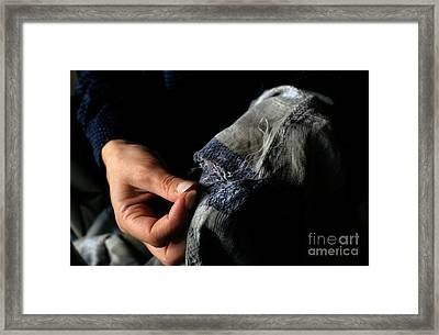 Woman Fixing A Hole With A Needle And Thread Framed Print by Sami Sarkis
