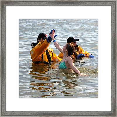Woman Gives High-five In The Water During Polar Bear Plunge Framed Print by Ben Schumin