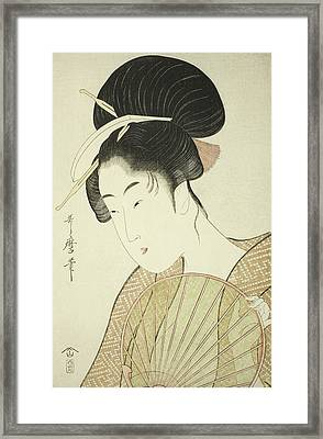 Woman Holding A Round Fan Framed Print by Kitagawa Utamaro