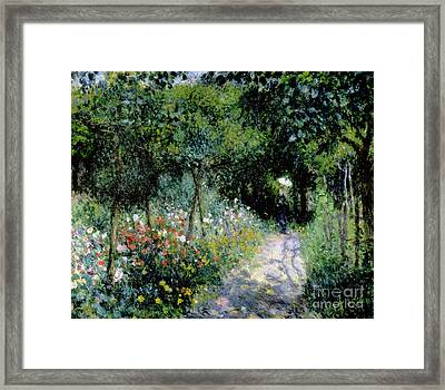 Woman In A Garden Framed Print by Pierre Auguste Renoir