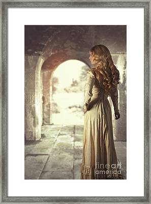 Woman In Archway Framed Print by Amanda And Christopher Elwell