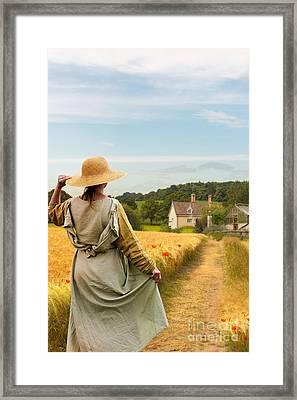 Woman In Field Framed Print by Amanda Elwell