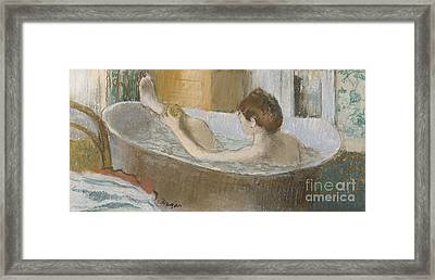 Woman In Her Bath Framed Print by Edgar Degas