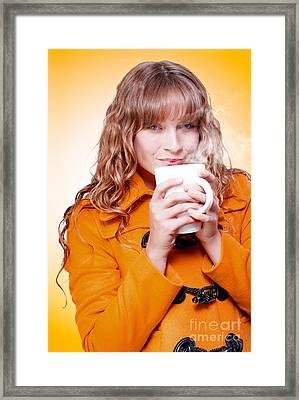 Woman In Warm Winter Coat Sipping Hot Coffee Framed Print by Jorgo Photography - Wall Art Gallery