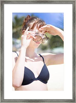 Woman Looking Over Sunglasses Framed Print by Jorgo Photography - Wall Art Gallery