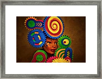 Woman Of Colors  Framed Print by Jeff  Gettis