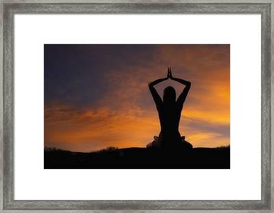 Woman Practicing Yoga Framed Print by Utah Images
