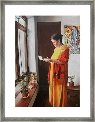 Woman Reading A Letter Framed Print by Kevin Hopkins