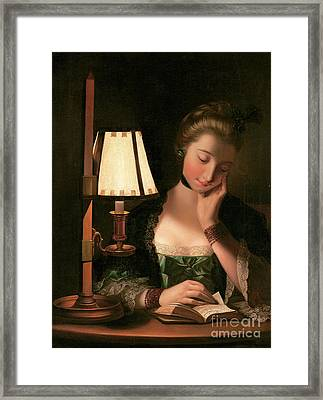 Woman Reading By A Paper Bell Shade Framed Print by Henry Robert Morland