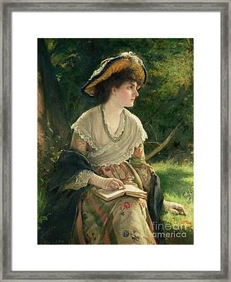 Woman Reading Framed Print by Robert James Gordon