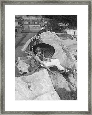 Woman Relaxing In Torquay Framed Print by Underwood Archives