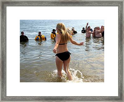 Woman Runs Into The Water During Polar Bear Plunge Framed Print by Ben Schumin