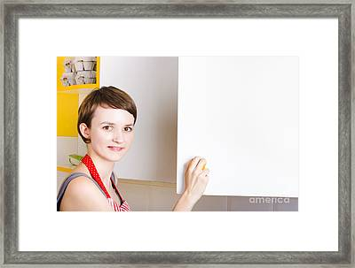 Woman Searching Kitchen Cupboard For Ingredients Framed Print by Jorgo Photography - Wall Art Gallery
