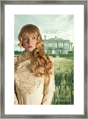 Woman Standing Outside Manor House Framed Print by Amanda And Christopher Elwell