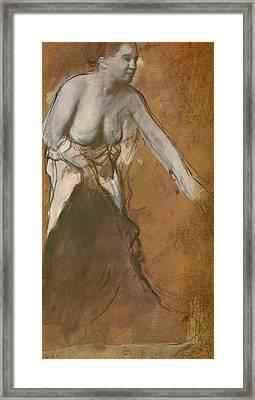 Woman Washing Herself Framed Print by Edgar Degas