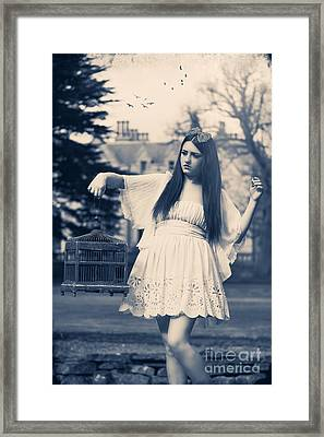 Woman With Birdcage Framed Print by Amanda And Christopher Elwell