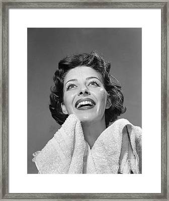 Woman With Towel Smiling, 1950s Framed Print by Debrocke/ClassicStock