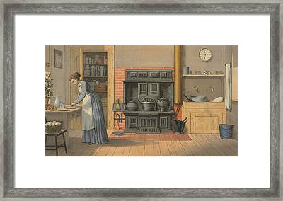 Woman Working In An Up-to-date Kitchen Framed Print by Everett