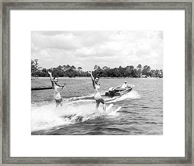 Women Water Skiers Waving Framed Print by Underwood Archives