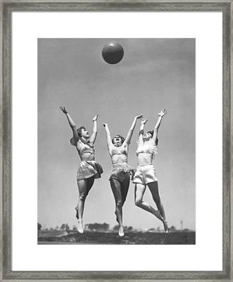 Women With Medicine Ball Framed Print by Underwood Archives