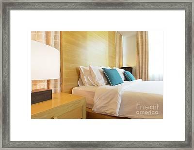 Wood Bed Framed Print by Atiketta Sangasaeng