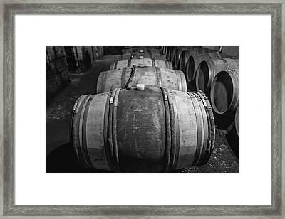 Wooden Barrels In A Wine Cellar Framed Print by Georgia Fowler