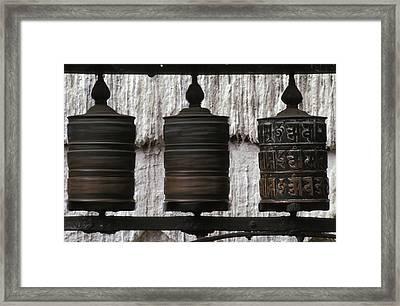 Wooden Prayer Wheels Framed Print by Sean White