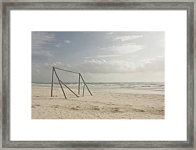 Wooden Soccer Net On Beach Framed Print by Bailey