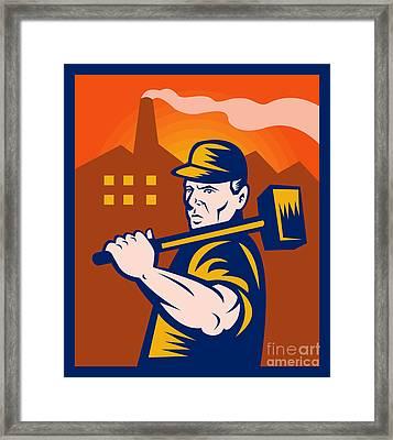 Worker With Sledgehammer Framed Print by Aloysius Patrimonio