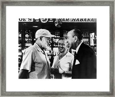 Writer Ernest Hemingway Chats Framed Print by Everett