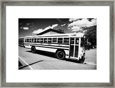 yellow american bluebird school bus in Lynchburg tennessee usa Framed Print by Joe Fox