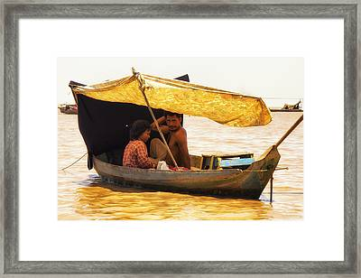 Yellow Boat Reflections Framed Print by Georgia Fowler