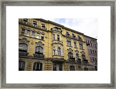 Yellow Building In Salzburg Framed Print by John Rizzuto