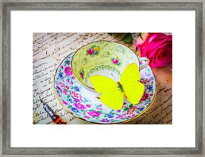 Yellow Butterfly On Tea Cup Framed Print by Garry Gay