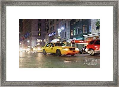 Yellow Cab At Night In New York City In Motion Blu. Framed Print by Antonio Gravante